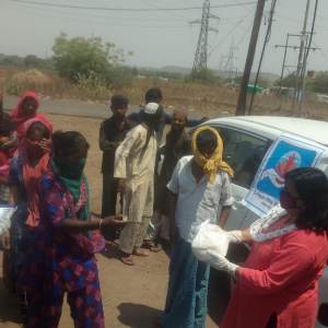 Distributing food parcels to families
