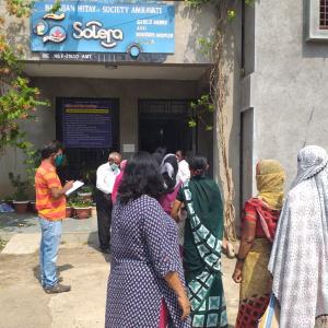 Women outside the Bahujan Hitaya Society project