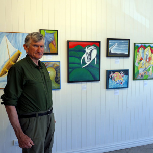 David Litchfield with his paintings