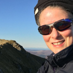 Animisha on top of Marsco, one of the Red Cuillin on the Isle of Skye, Scotland